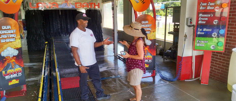 Car Services in Montgomery, AL - car wash manager answering customer questions