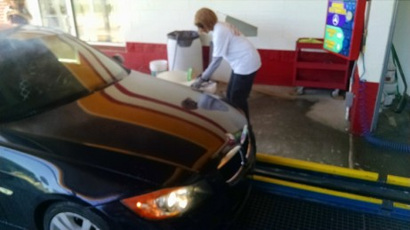 Car cleaning professional at work