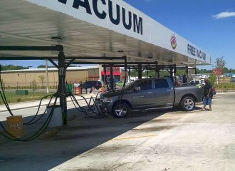 Car Vacuuming in Montgomery, AL - customer using free car vacuuming station for his pickup truck
