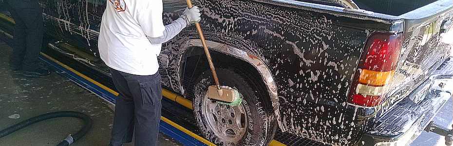 Pickup Truck Washing in Montgomery, AL - black pickup truck being soaped down during pretreatment