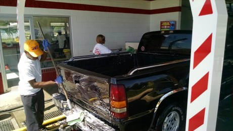 Soaping down tailgate and rear step bumper - Zoom Zoom Truck Washing Montgomery, AL