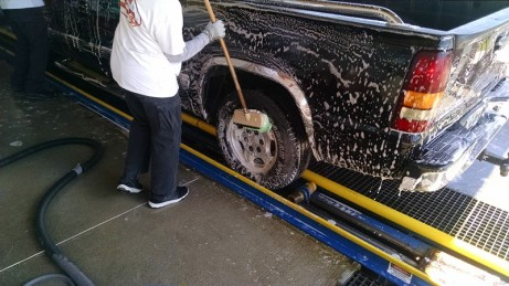 Pre scrubbing truck tires - Zoom Zoom Truck Washing